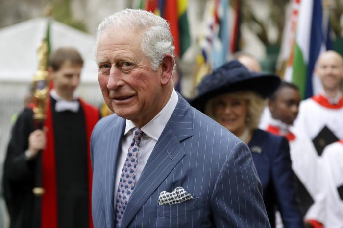 Britain's Prince Charles and Camilla the Duchess of Cornwall, in the background, leave after attending the annual Commonwealth Day service at Westminster Abbey in London.