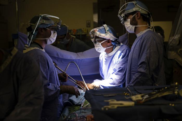 A doctor, center, directs a special camera to look at a patient's tumor at a hospital in Philadelphia.