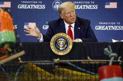 President Donald Trump speaks during a roundtable discussion with commercial fishermen at Bangor International Airport in Bangor, Maine, Friday, June 5, 2020