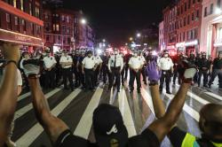 Protesters take a knee on Flatbush Avenue in front of New York City police officers during a solidarity rally for George Floyd, Thursday, June 4, 2020, in the Brooklyn borough of New York