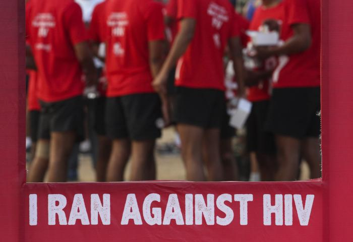 Indians participate in a health awareness run to mark World AIDS Day in Hyderabad, India.