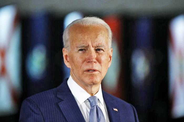 In this March 10, 2020, file photo Democratic presidential candidate former Vice President Joe Biden speaks to members of the press at the National Constitution Center in Philadelphia
