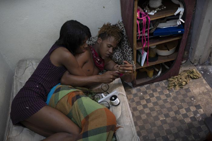 Transgender Klay Kardashian, left, and Marshall, listen to a voice message in Klay's room at the squat known as Casa Nem.