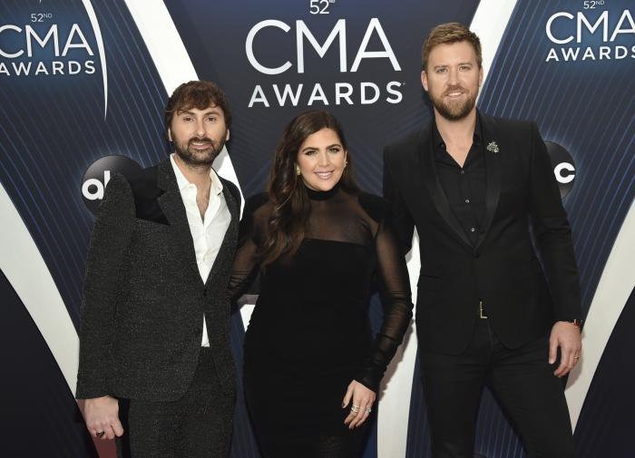 Dave Haywood, from left, Hillary Scott and Charles Kelley, of Lady A, formerly Lady Antebellum, arrive at the 52nd annual CMA Awards in Nashville, Tenn.