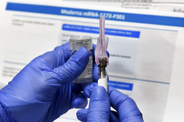 In this Monday, July 27, 2020 file photo, a nurse prepares a shot as a study of a possible COVID-19 vaccine, developed by the National Institutes of Health and Moderna Inc.