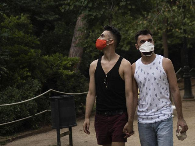Piotr Grabarczyk and his boyfriend Kamil Pawlik, right, walk in a park near the Sagrada Familia basilica in Barcelona, Spain.