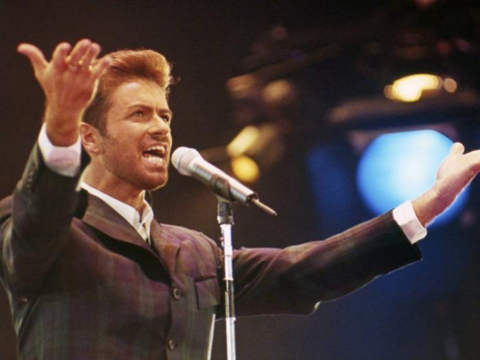 "In this Dec. 2, 1993 file photo, George Michael performs at ""Concert of Hope"" to mark World AIDS Day at London's Wembley Arena"