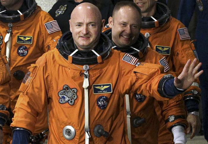 In this May 16, 2011, file photo, former NASA astronaut STS-134 commander Mark Kelly, front