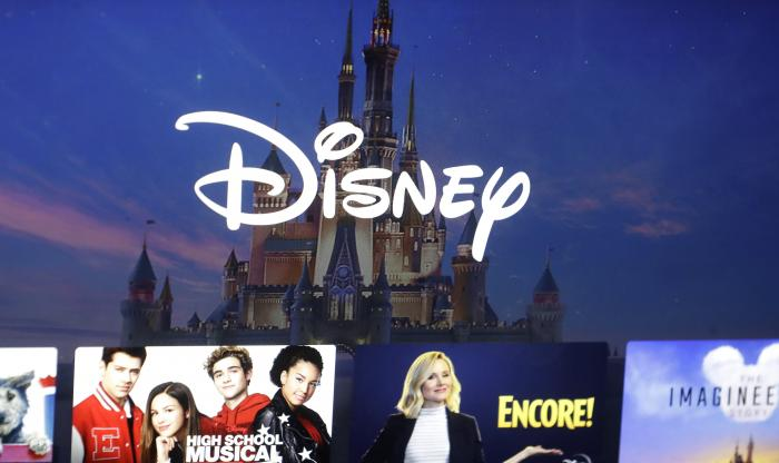 A Disney logo forms part of a menu for the Disney Plus movie and entertainment streaming service on a computer screen in Walpole, Mass.