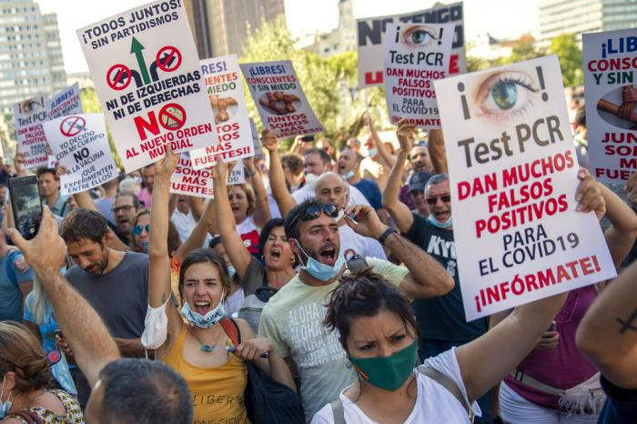 Demonstrators attend a protest against nationwide restrictions against COVID-19 in Madrid, Spain.