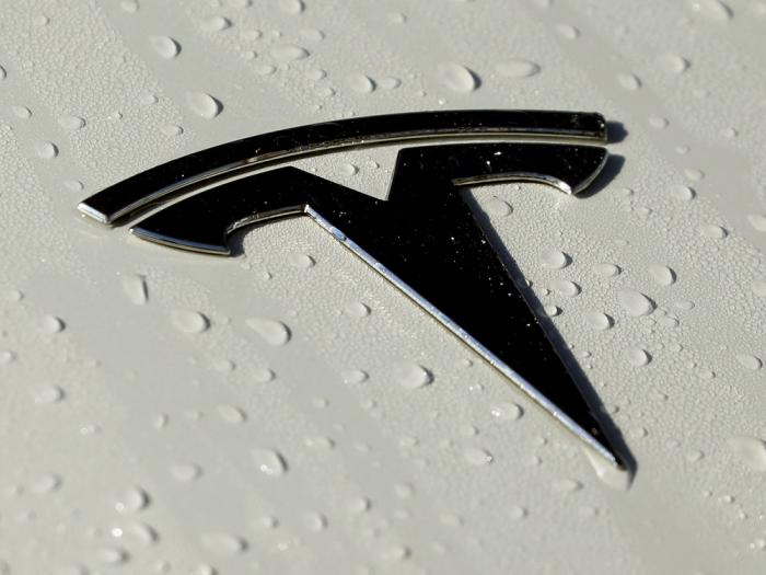 This Oct. 18, 2019, photo shows a Tesla logo in Salt Lake City