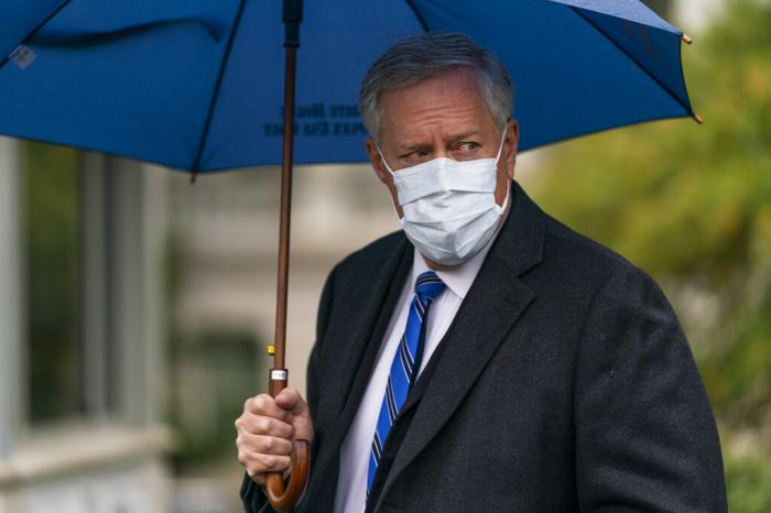 White House chief of staff Mark Meadows responds to reporters questions outside the West Wing on the North Lawn of the White House in Washington.