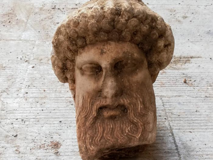 In this undated photo, provided by the Greek Culture Ministry on Sunday, Nov. 15, 2020, a head of the ancient god Hermes is pictured after being found during sewage works in central Athens