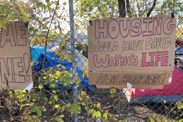 A sign at a homeless encampment near a Chicago expressway memorializes a man who reportedly died there from exposure to the cold.