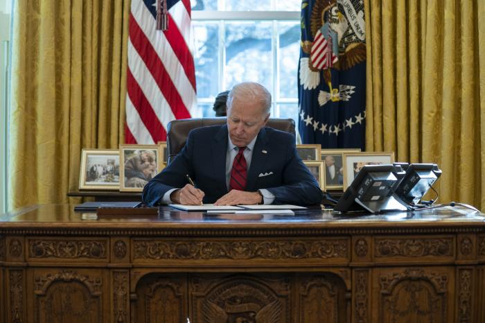 President Joe Biden signs a series of executive orders on health care, in the Oval Office of the White House in Washington.
