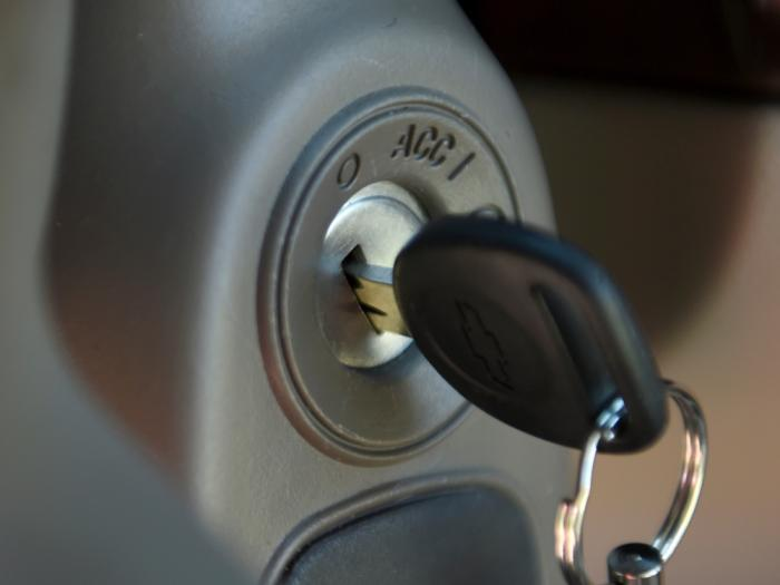 This April 1, 2014, file photo shows a key in the ignition switch of a 2005 Chevrolet Cobalt in Alexandria, Va.