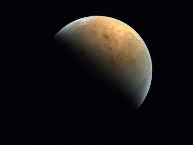 """This Feb. 10, 2021 image taken by the United Arab Emirates' """"Amal,"""" or """"Hope,"""" probe was released Sunday, Feb. 14, 2021, shows Mars"""