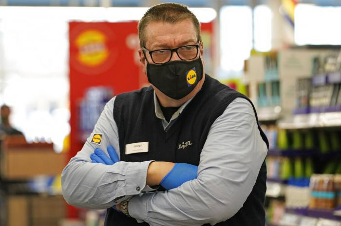 Lidl grocery market supervisor Joseph Lupo pauses in an aisle at the store where he works in Lake Grove, N.Y.