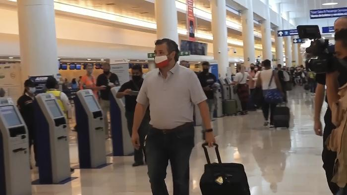Sen. Ted Cruz, R-Texas, walks to check in for his flight back to the U.S., at Cancun International Airport in Cancun, Mexico.