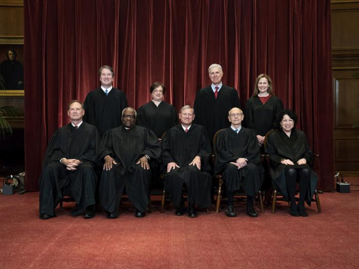 In this April 23, 2021, file photo members of the Supreme Court pose for a group photo at the Supreme Court in Washington