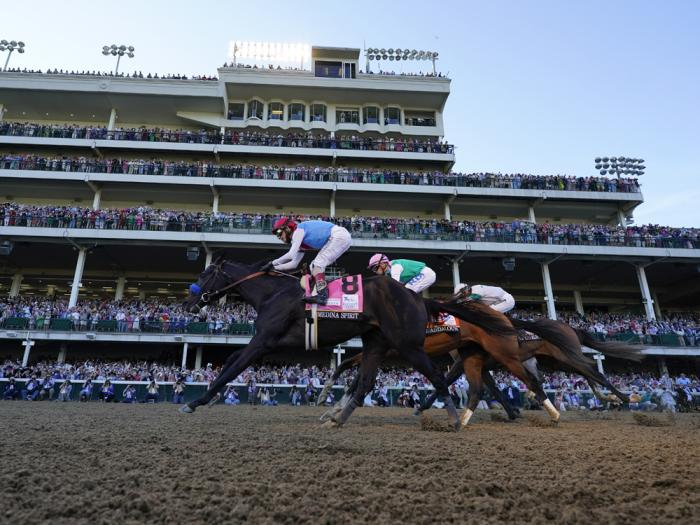 John Velazquez riding Medina Spirit leads Florent Geroux on Mandaloun and Flavien Prat riding Hot Rod Charlie to win the 147th running of the Kentucky Derby at Churchill Downs, Saturday, May 1, 2021, in Louisville, Ky.