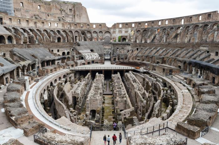 In this April 26, 2021 file photo, few visitors arrive for their tour of the ancient Colosseum, in Rome