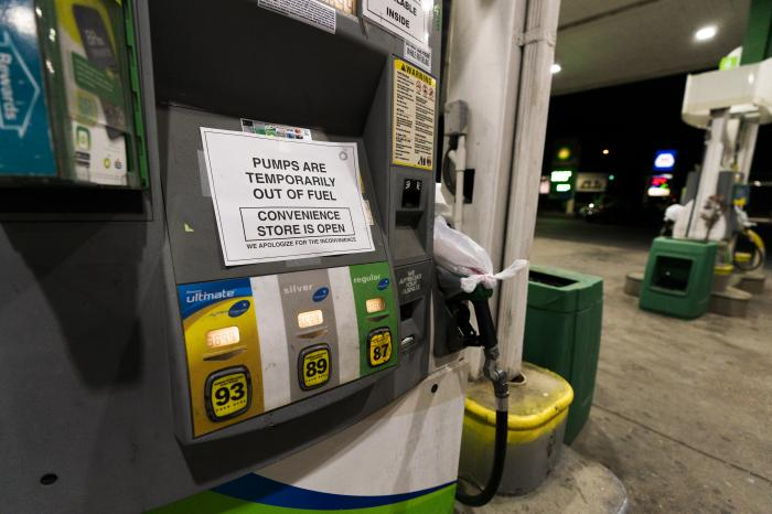 A pump at a gas station in Silver Spring, Md., is out of service, notifying customers they are out of fuel, Thursday, May 13, 2021.