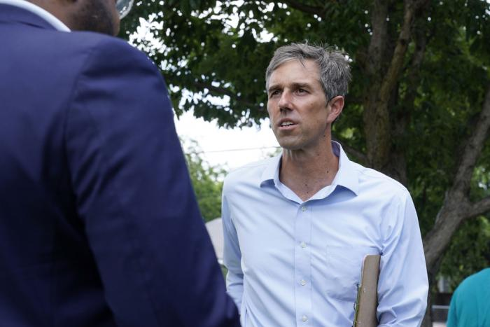 Beto O'Rourke, right, listens to a volunteer before a Texas Organizing Project neighborhood walk in West Dallas Wednesday, June 9, 20
