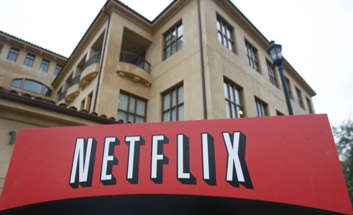 The company logo and view of Netflix headquarters in Los Gatos, Calif.