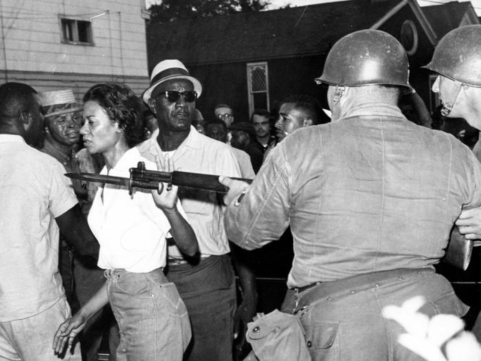 In this July 21, 1963, file photo, Gloria Richardson, head of the Cambridge Nonviolent Action Committee, pushes a National Guardsman's bayonet aside as she moves among a crowd of African Americans to convince them to disperse in Cambridge, Md.