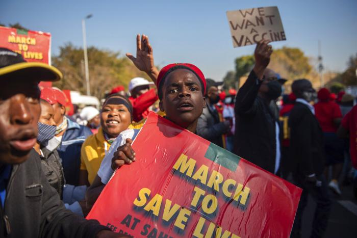 Members of the Economic Freedom Fighters stage a protest in Pretoria, South Africa, demanding that vaccines from China and Russia be included in the country's vaccine rollout program.
