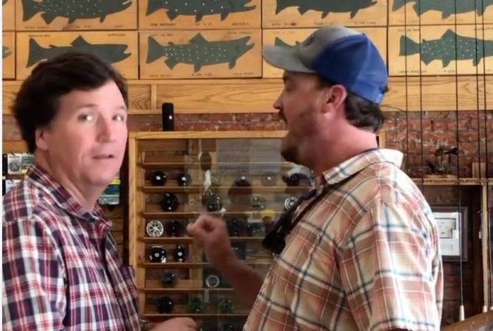 Tucker Carlson (left) confronted by Montana man Dan Bailey at a sporting goods store.
