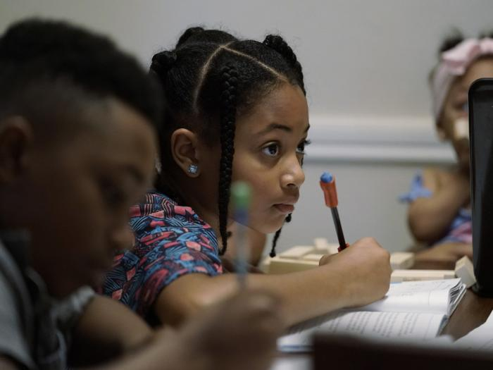 Jacoby Brown, 11, left, and sister, 9, practice math at their home in Austin, Texas, Tuesday, July 13, 2021