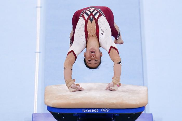 Kim Bui, of Germany, performs on the vault during the women's artistic gymnastic qualifications at the 2020 Summer Olympics.