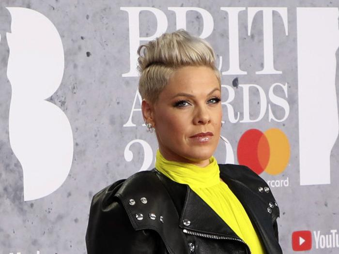 In Wednesday, Feb. 20, 2019 file photo, singer Pink poses for photographers upon arrival at the Brit Awards in London