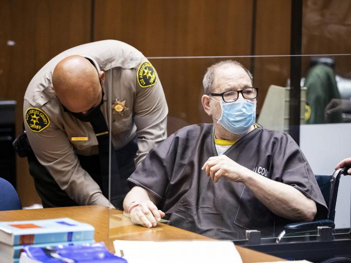 Harvey Weinstein, the 69-year-old convicted rapist and disgraced movie mogul, wears a face mask behind a protective plexiglass screen, as he listens in court during a pre-trial hearing in Los Angeles, Thursday, July 29, 2021