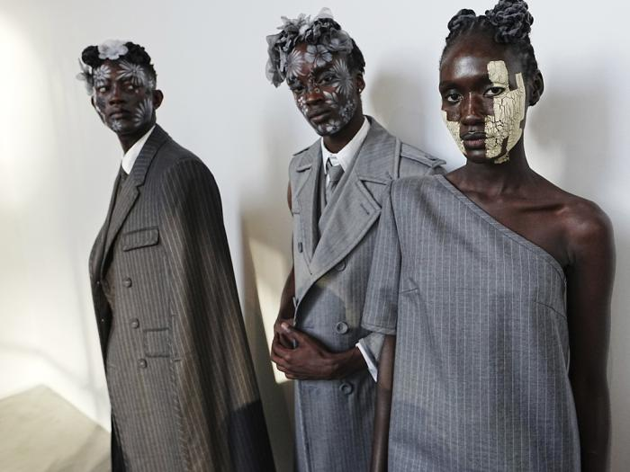 Models appear backstage in preparation for the Thom Browne fashion show during New York Fashion Week at The Shed, on Saturday, Sept. 11, 2021, in New York