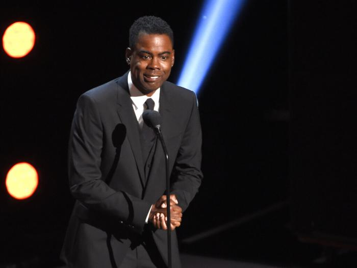 In this March 30, 2019 file photo, Chris Rock presents the award for outstanding comedy series at the 50th annual NAACP Image Awards at the Dolby Theatre in Los Angeles.